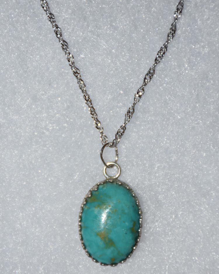 Silver necklace with oval blue stone